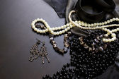 Pearl necklace and earrings on the black table — Stock Photo