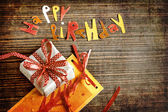 Vintage gift box (package) with words happy birthday on wooden background — Zdjęcie stockowe