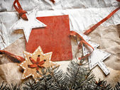 Christmas decoration over grunge wooden background — Stock Photo