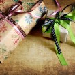 Gifts with packaging paper and atlas bows - Stock Photo