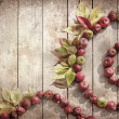 Vintage Autumn border from apples and fallen leaves on old wooden table — Stock Photo #24980867