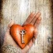 Heart with the key in women hand as a symbol of love — Stok fotoğraf