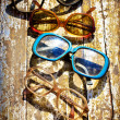 Close-up of retro glasses against vintage background — Stock Photo #24981859
