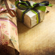 Gifts with packaging paper and atlas bows — Stock Photo
