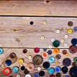 Stock Photo: Set of vintage buttons on old wooden table