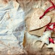 Christmas heart with star and tree on vintage paper background — Стоковая фотография