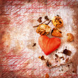 Heart as a symbol of love, vintage card with red heart and dry roses on grunge old background - Stok fotoğraf