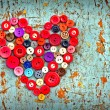Red heart background on vintage old surfaces — Stock Photo #24985427