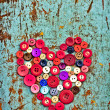 Red heart background on vintage old surfaces — Stock Photo #24985433