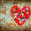 Red heart background on vintage old surface — Stock Photo #24985453