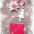 Christmas decoration over grunge paper background — Stock Photo #24985523