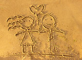 Lovers drawn in the sand — Stock Photo