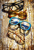 Close-up of retro glasses against vintage background — Stock Photo