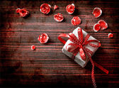 Gift box on wooden table — Stock Photo