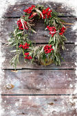 Wreath of leaves with rowan on wooden grunge background — Stock Photo