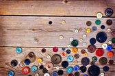 Set of vintage buttons on old wooden table — Stock Photo