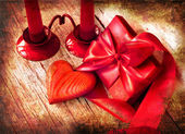 Valentines Day background with heart and holidays gift on old wooden background with two candle — Stock Photo