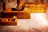 Old wooden jointers,jack-plane on the wood table with grunge texture — Stock Photo