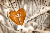 Vintage card with red heart on the snow tree branches — Stock Photo
