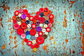 Red heart background on vintage old surfaces — Stock Photo