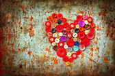 Red heart background on vintage old surface — Stock Photo