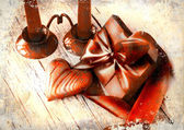 Valentines Day background with heart and holidays gift on old wooden background with two candle. — Stock Photo
