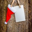 Christmas decoration with paper and Santa hat — ストック写真