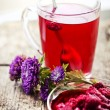 Raspberry hot drink , jam and flowers — Stock Photo #35724113
