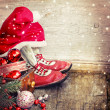 Christmas decorations, Santa hat and red shoes — Stock Photo #35724173