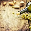 Stock Photo: Bottle of white wine, grape and corks