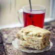 Cake with cup of hot fruite tea — Stock Photo