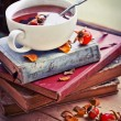 Rosehip tea on old books — Stock Photo