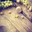 Bottle of white wine, grape and corks — Stock Photo