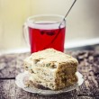 Cake with cup of hot fruite tea — Stock Photo #35724995