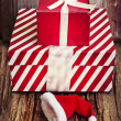Red gift boxes and Santa hat — Stock Photo
