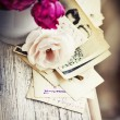 Roses with old letters and postcards — Stock Photo #35725019