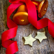 Christmas bells and golden stars — Stock Photo