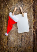 Christmas decoration with paper and Santa hat — Stock Photo