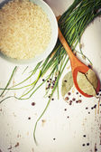 Bowl of rice with spices and fresh herbs — Stock Photo