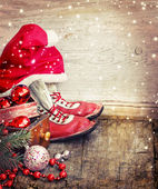 Christmas decorations, Santa hat and red shoes — Stock Photo
