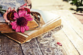 Gerberas on antique books — Stock Photo