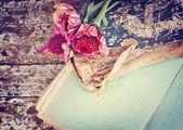 Gerberas on antique books — Stock Photo