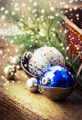 Christmas balls in old pot — Stock Photo