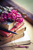 Dry roses and books — Stock Photo