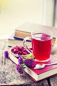 Hot tea, flowers and books — Stok fotoğraf
