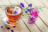 Herbal tea with flowers — Stock Photo