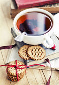 Cookies, books and tea — Stok fotoğraf