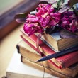 Stock Photo: Books, pen and roses