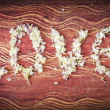 Word Love from petals on old vintage wood plates — Stock Photo