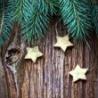 Christmas pine branches and stars — Stock Photo
